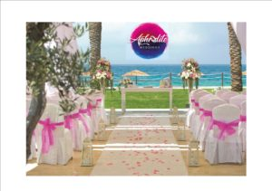 Beach wedding ceremony set up and Aphrodite Weddings logo