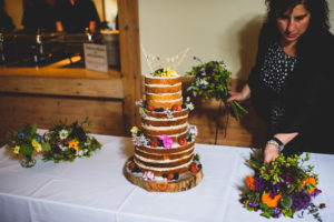 Wedding Planner arranging flowers on cake table
