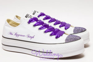 White platform trainers with bright purple silk laces, purple crystals on the toes and Mrs on the side