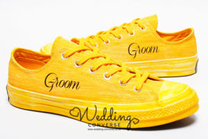 Bright yellow groom trainers and groom appears on the side