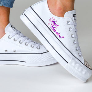 White platform trainer with bright pink just married on the side