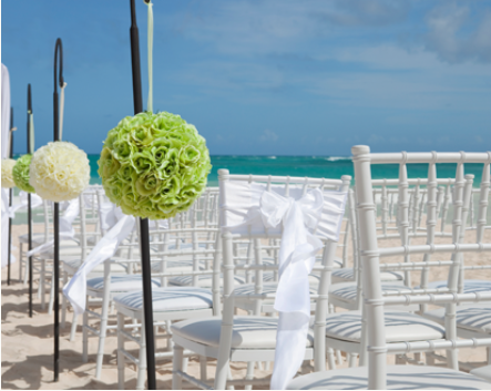 chairs set up for beach wedding and rose aisle