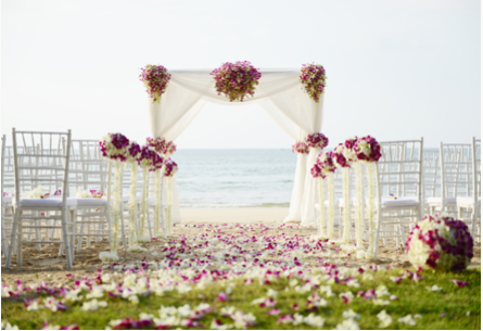 Petal laid beach wedding aisle with quare decorated at top of aisle
