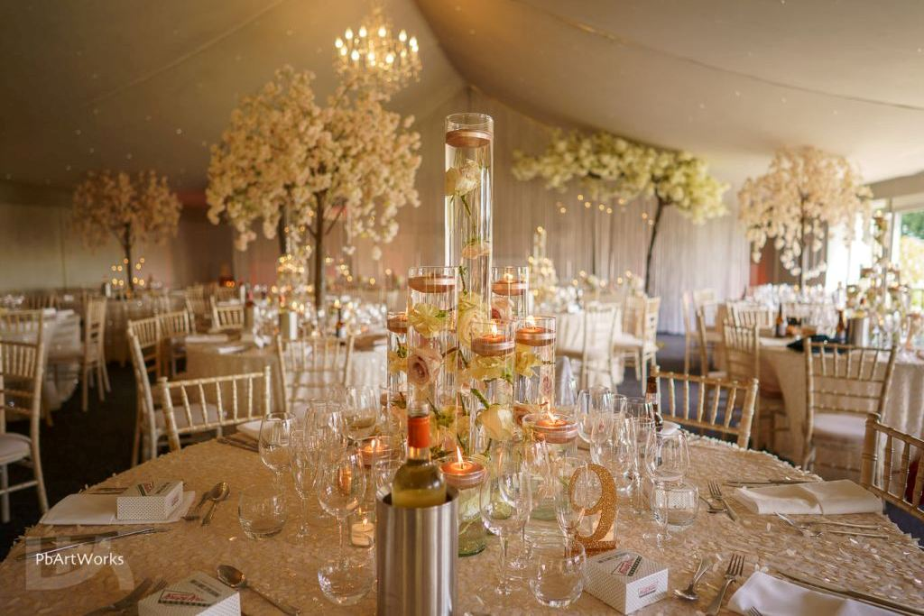 Wedding reception with trees and candles